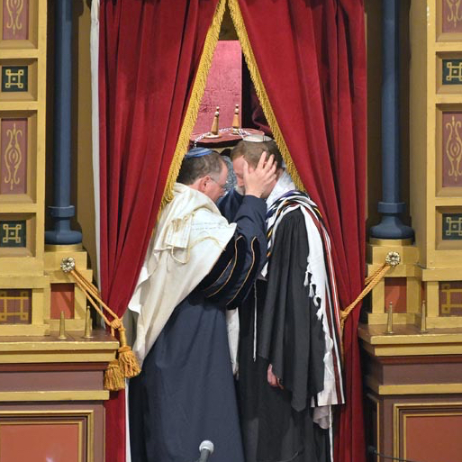 """Me standing with Rabbi Aaron Panken z""""l, with his hands on my head, in the ark at Plum Street Temple in Cincinnati at the moment of ordination."""